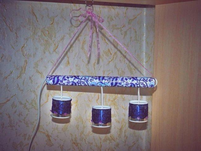 Как можно собрать красивый светильник из металлических баночек